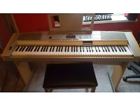 Yamaha DGX 500 electronic piano with wooden frame