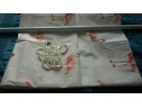 White shower curtain with flamingo print complete with rings and extendable pole