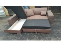 Lovely BRAND NEW brown fabric corner sofa bed with storage. can deliver