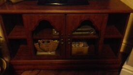 Tv cabinet..dark coloured great condition. Just a couple of scratches on the sides