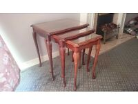 Three wooden tables, table with two pull out side tables, very good condition