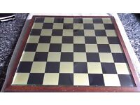 Stunning old brass chess set and mahogany board.