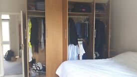IKEA PAX Oak Finish Wardrobes.