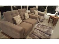 Nearly new two seater sofa and chair.