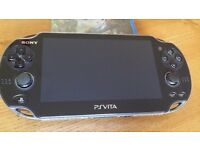 PS Vita, Charger, Box, Games (Uncharted Golden Abyss, COD Black Ops Declassified) + 8gb Memory Card