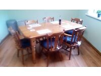 Solid pine table and 6 chairs very strong and fairly good condition