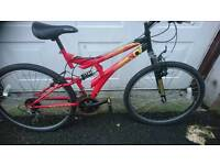 UNIVERSAL MENS MOUNTAIN BIKE, 18 INCH FRAME 26 INCH WHEEL'S 18 GEARS GOOD TO GO.