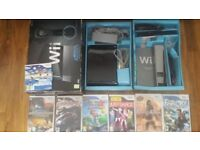 Wii game console (black) and 6 games