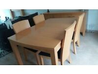Extendable dining table, 4 chairs,sideboard, and fire surround.