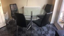 Oval glass table and 4 black chairs
