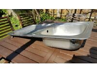 Used Stainless steel kitchen sink.