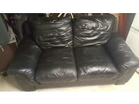 Black leather settee and footstool