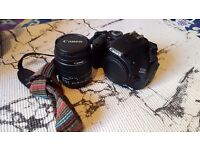 Canon 600d with kit lens, battery grip and more - £300