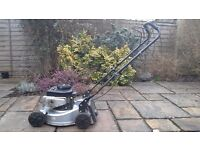 Petrol lawnmower in good working condition, collapsible handle and user manual