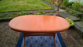 Extending Dining room table with 8 chairs