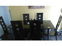 Large black 6 seater dining room table for sale