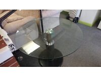Oval glass dining table with marble