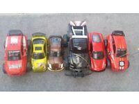 Toy cars...Ferrari, nissan350z, dodge