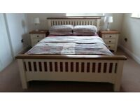 Bedroom furniture set - co-ordinating bed frame, bedside cabinets and chest of drawers.