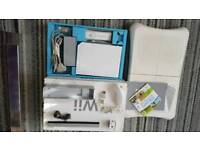Boxed Nintendo Wii console with wii fit board and all accessories