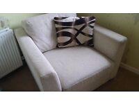 Large beige armchair
