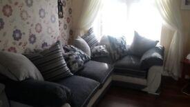 Corner sofa. Light grey dark grey and black stunning sofa