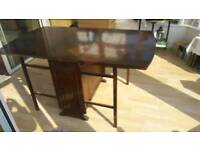 Quality vintage drop leaf table with storage
