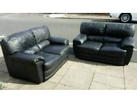 Two black matching leather sofas