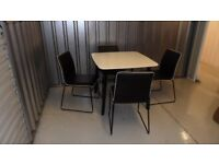 White Dining Table And Four Chairs