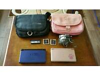 Two Nintendo DS Lites, two game cards and two bags/cases for sale