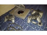 Playstation 1 with games and 4 controllers