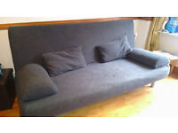 Ikea sofabed with cushions