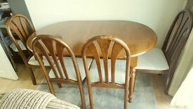 lovely walnut extendable wooden diningtable and 4 chairs