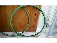 Two Green 700c bike tyres