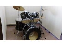 Retired drum teacher has a Pearl Export drum kit with cymbals for sale.