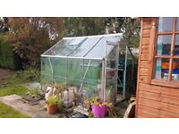8 x 6 aluminium greenhouse metal frame with glass panels also included with a wooden potting bench