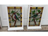 Colourful bird-themed stained glass windows