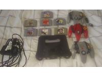 Nintendo 64, 3 controllers + 7 games...including golden eye and mario kart 64
