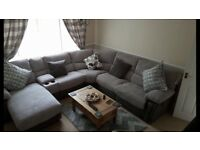 Large corner sofa with 2 recliners, 1 large seat with built in foot rest.