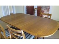 Dining table, golden brown wood, extendible.
