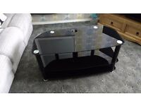 TV glass top stand.As new, 39 inches long 18 inches wide and 20 inches high