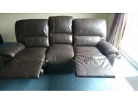 Leather sofa with recliners
