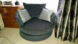 DFS Black swivel cuddle chair excellent condition