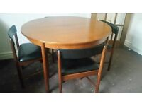 Round extending dining table with 4 chairs. Possibly G plan