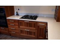 Andersons fitted kitchen in walnut wood with quartz worktops plus appliances, in good condition