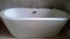 Lovely Bathstore Trend double ended bath with surround - as new. l month old with taps waste etc