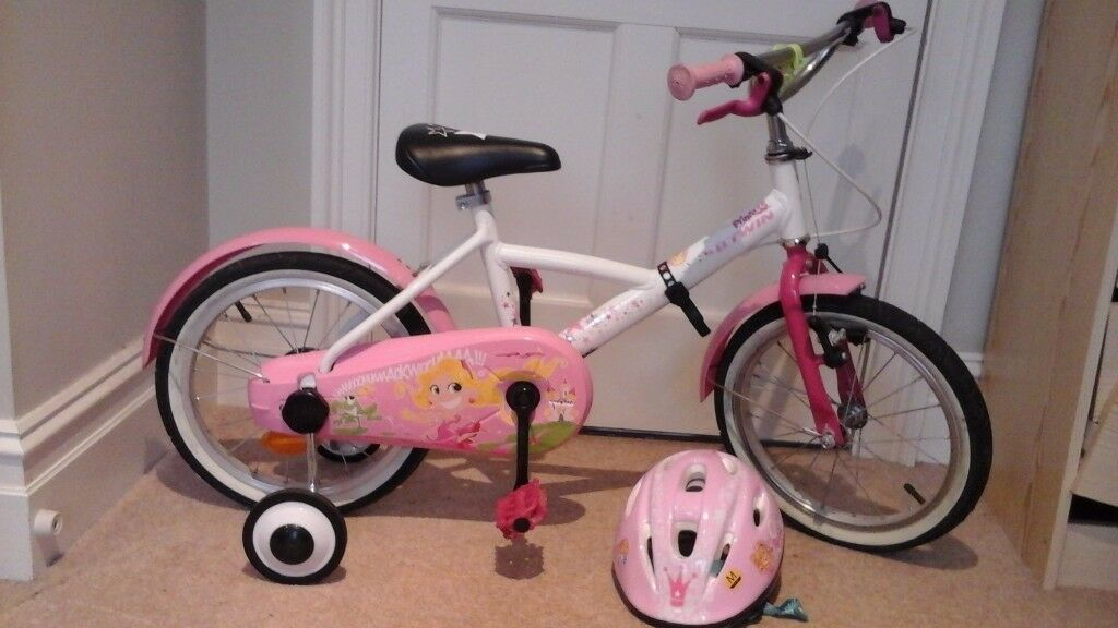 Lovely pink bike 16'' with adjustable removable stabilisers and helmet