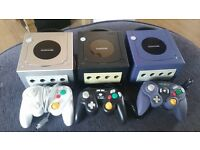 3 Nintendo GameCubes and controllers