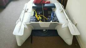 Inflatable boat, electric motor & battery + 2hp petrol outboard
