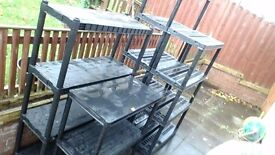 4 sturdy black plastic shelving units ideal for garden sheds ect